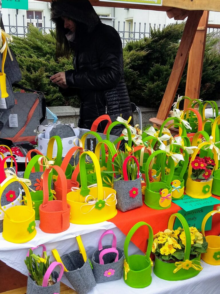 Stall at Polish Easter Festival with colorful felt baskets for sale