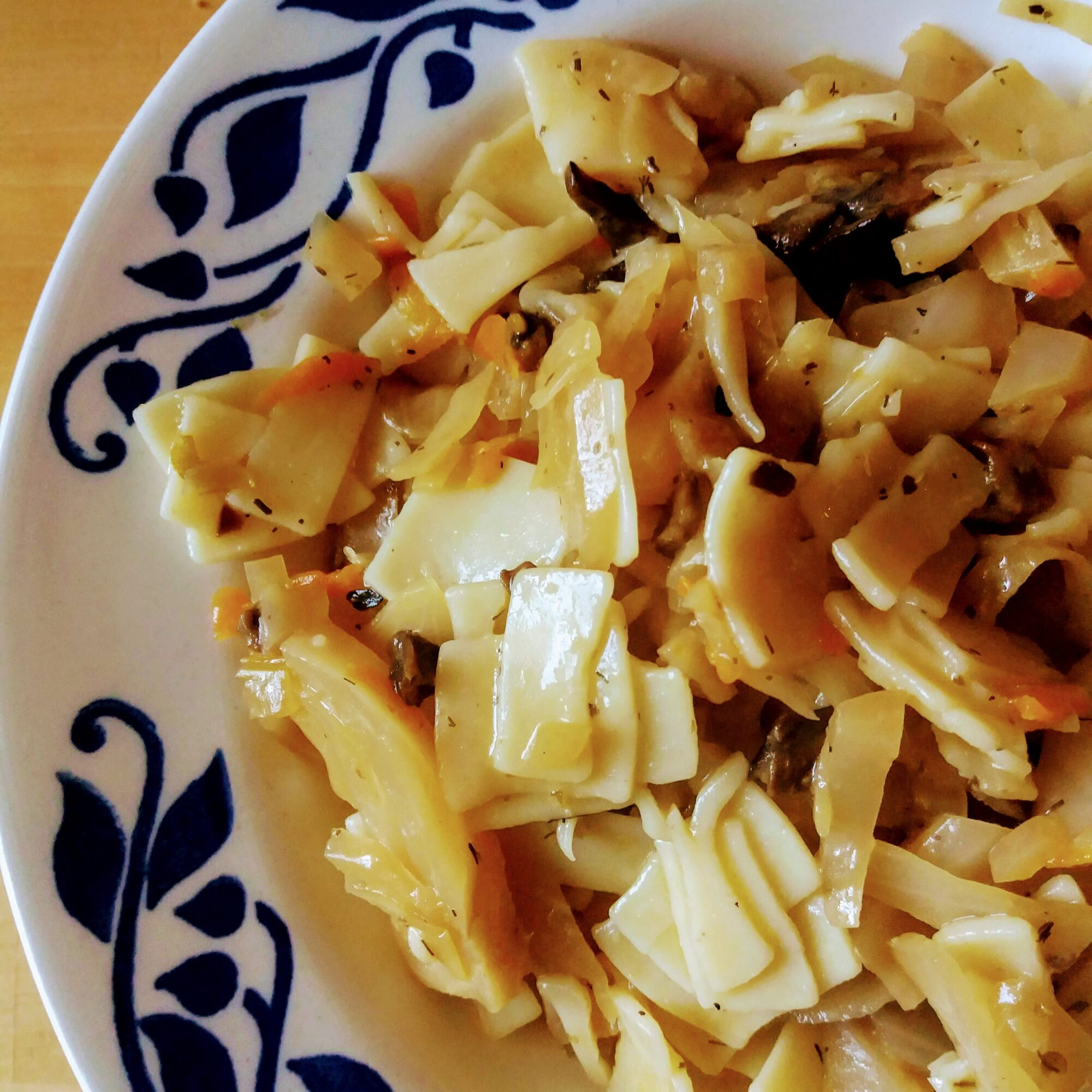 A bowl of noodles with cabbage and mushrooms call Łazanki in Polish.