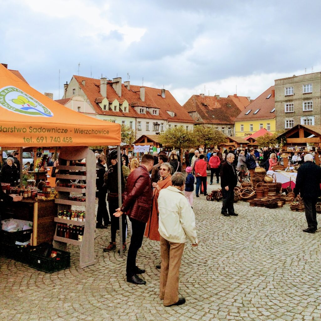 A small town festival in Poland for Easter with stalls of food and decorations.