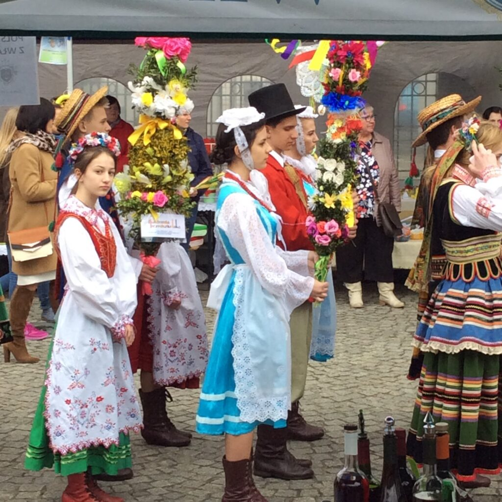 People in Polish national costume presenting Palm Sunday palms
