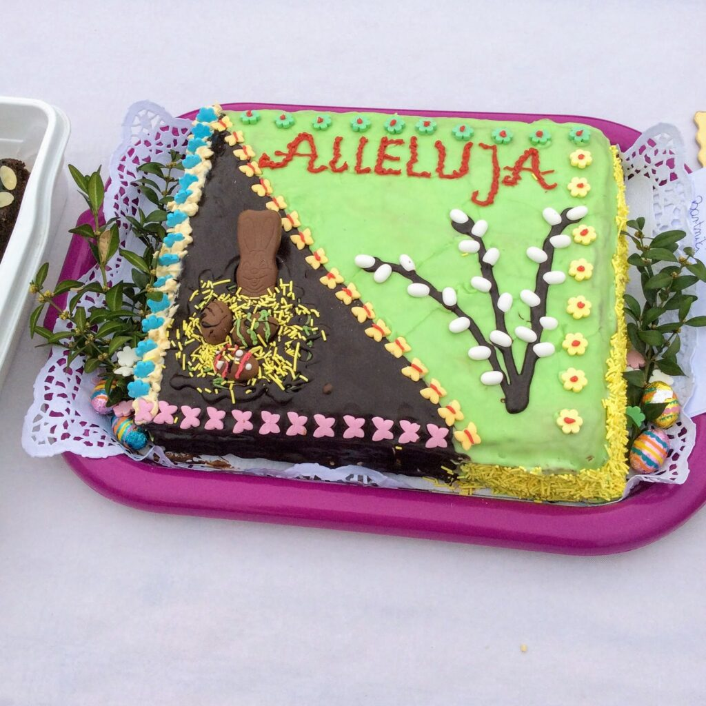 Polish Easter cake with Alleluja and pussy willow decorations.