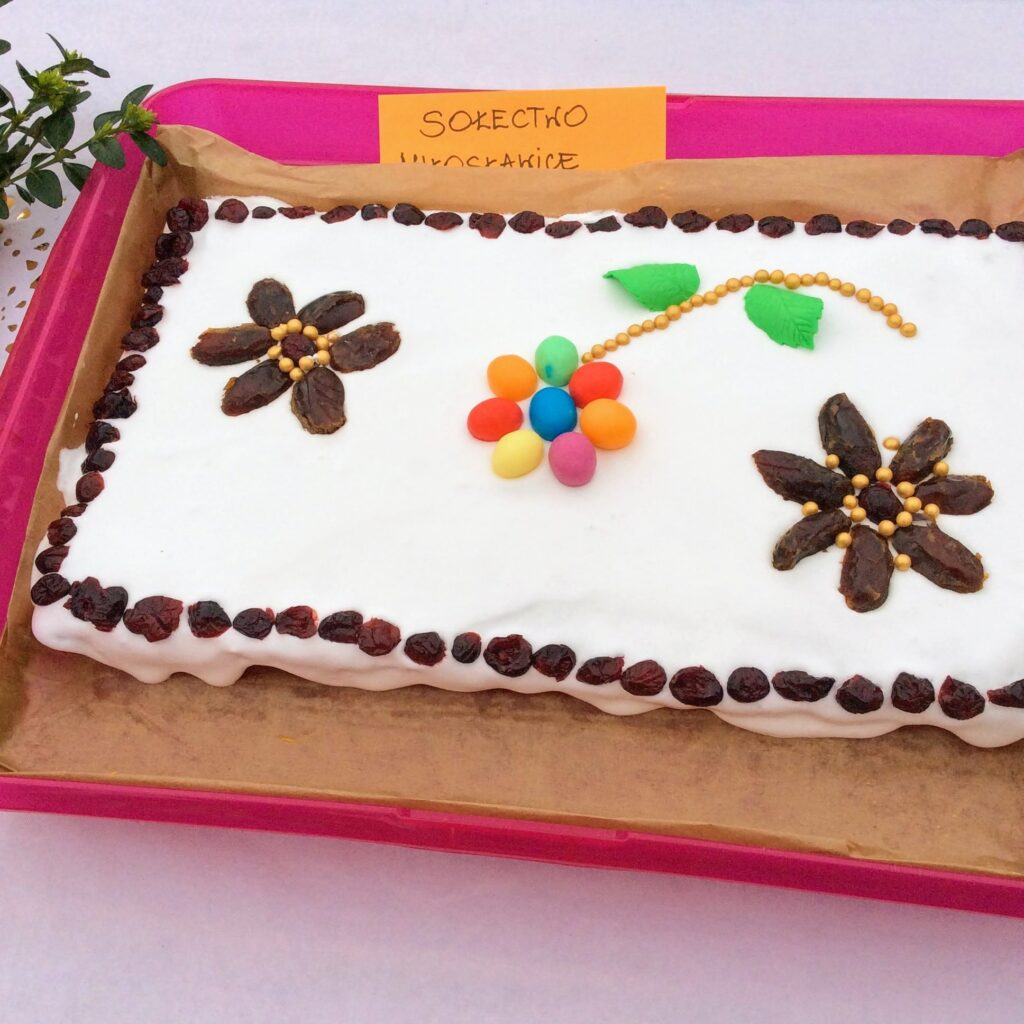 Polish Easter cake, rectangular, white decorated with 3 candy flowers