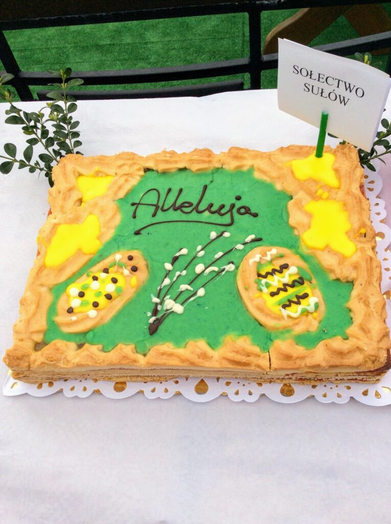 Polish Easter cake in green and yellow decorated with Easter eggs and pussy willow.