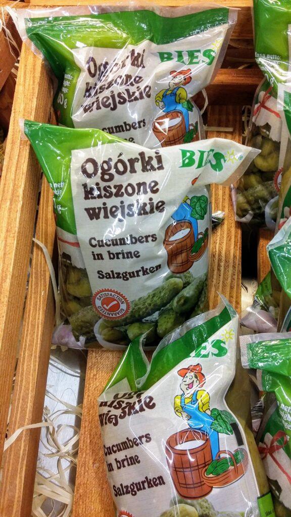 A supermarket shelf with bags of cucumbers in brine