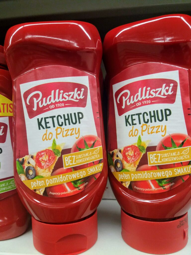 Two bottles of Polish Pudliszki brand ketchup especially for pizza