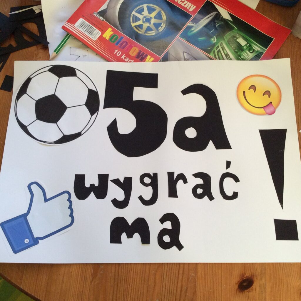 Poster for Children's Day sports competition saying in Polish 5a must win!